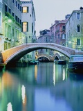 Bridge above a channel in Venice, evening shot Photographic Print by Guenter Rossenbach