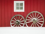 Wagon Wheels on Snow Against Stable Photographic Print by Stuart Westmorland