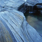 Strata in Rock Formation Along Verzasca River Photographic Print by Micha Pawlitzki