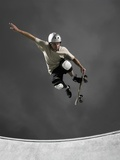 Skateboarder Performing Tricks Papier Photo