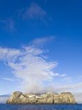 Morning Fog Over Small Rocky Island at South Shetland Islands Photographic Print by John Eastcott & Yva Momatiuk