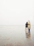 Man with surfboard Photographic Print by Tomas Rodriguez