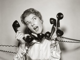 1950s 1960s Overwhelmed Stressed Woman Answering Four Black Telephone Phone Receivers At One Time Photographic Print by  DeBrocke
