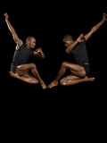 Two male dancers jumping Photographic Print