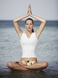 Woman meditating in the ocean Photographic Print by Olivier Cadeaux