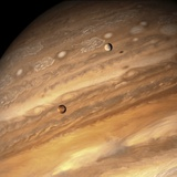 Io and Europa over Jupiter Photographic Print by Michael Benson