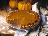 Pumpkin Pie with Slice Removed Photographic Print by  Envision