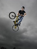 BMX Biker Performing Tricks Photographic Print
