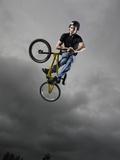 BMX Biker Performing Tricks Photographic Print