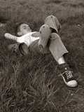 1960s Boy Sleeping In Grass Legs Crossed Holes In Sneakers Baseball Mitt By His Side Photographic Print by H. Armstrong Roberts