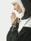 Praying Nun Holding Rosary Photographic Print