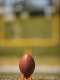 Football on Tee Photographic Print by Robert Michael