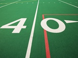 Forty Yard Maker on Football Field Photographic Print by David Papazian
