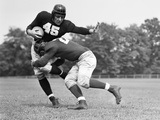 1940s Football Player Being Tackled Photographie par H. Armstrong Roberts