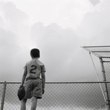 Boy in baseball uniform Photographic Print by Steve Cicero