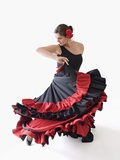 Salsa dancer twirling her skirts Photographic Print by Jose Luis Pelaez