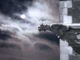 Gargoyle on Building at Night Photographic Print by Roger Brooks