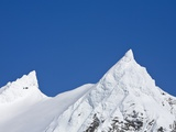 Snowy Peaks in Blue Sky Photographic Print by John Eastcott & Yva Momatiuk