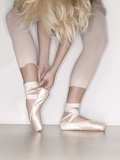Ballerina adjusting toe shoe Photographic Print by November