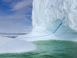 Iceberg with Long Cracks Floating Near Cape Evensen Photographic Print by John Eastcott & Yva Momatiuk