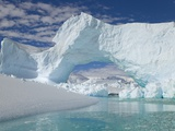Huge Arch in Iceberg Photographic Print by John Eastcott &amp; Yva Momatiuk