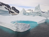 Stranded Icebergs in Shallow Bay Near Boothe Island Photographic Print by John Eastcott & Yva Momatiuk