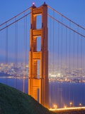 Tower of Golden Gate Bridge and San Francisco at Dusk Photographic Print by Julie Eggers