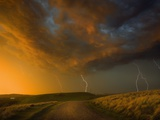 Thunderstorm and Orange Clouds at Sunset Photographic Print by Jonathan Hicks