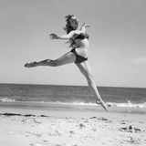 1950S Woman in Bikini Running and Jumping on the Beach Smiling Photographic Print by H. Armstrong Roberts