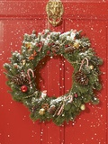 Christmas wreath hanging on a door Photographic Print by Peter Frank