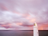 Lighthouse and Sunrise in Distance Photographic Print by Paul Hardy