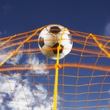 Soccer Ball Going Into Goal Net Impresso fotogrfica por Randy Faris