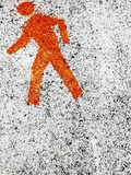 Pedestrian symbol on pavement Photographic Print by Jens Haas
