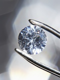 Diamond Held by Tweezers Photographic Print