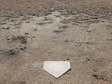 Home Plate on Field of Dirt and Dead Grass Photographic Print by Jim Vecchi