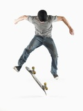 Young Skateboarder Doing Trick Photographic Print by J.P. Greenwood
