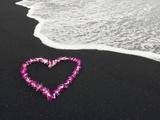 Heart Shaped Lei on Black Sand Beach Photographie