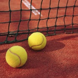 Tennis balls and net Photographic Print by Marcel Steger