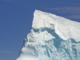 Pointy Blue Iceberg Sculpted by Waves Photographic Print by John Eastcott & Yva Momatiuk