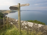 Direction Sign on Path Above Start Bay in Devon Photographic Print by Mark Bolton