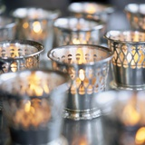 Many Votive Candles in Silver Holders Photographic Print by  Envision