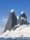 Snowcapped Pinnacles Rising from Coast Photographic Print by John Eastcott & Yva Momatiuk