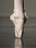 Feet of Ballet Dancer En Pointe Photographic Print by Erik Isakson
