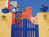 Gate to Brightly Painted House Photographic Print by Jean-pierre Lescourret