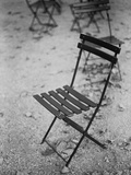 Folding chair in park Photographic Print by Michael Rubottom