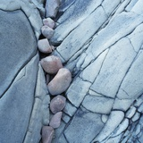 Rocks Against Cracked Boulder Photographic Print by Micha Pawlitzki