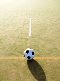 Football on astroturf field Photographic Print