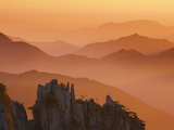 Yellow Mountains silhouetted in haze in China Photographic Print by Frank Krahmer