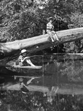 1940s 1950s Pair Of Boys In Straw Hats and Cuffed Jeans Fishing In Stream Photographic Print by H. Armstrong Roberts
