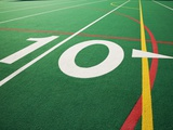 Ten Yard Maker on Football Field Photographic Print by David Papazian